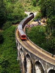 Train on Nine arch Bridge in Sri Lanka. Beautiful train track in hill country. Old bridge in Ceylon.