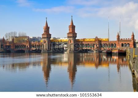 train on oberbaum bridge in berlin, germany