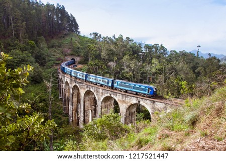 Train on the Nine Arches Demodara Bridge or the Bridge in the sky , Sri Lanka. Nine Arches Bridge is located in Demodara near Ella city Sri Lanka.