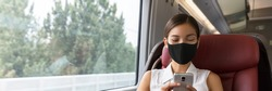 Train passenger Asian business woman using mobile phone during travel commute wearing face mask for corona virus pandemic. Panoramic banner of businesspeople commuting.