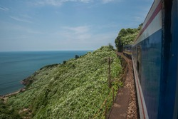 Train passes the sea, the hills, and jungle at the Hai Van Pass between Hue and Da Nang in Central Vietnam