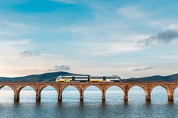Train passing over the bridge that crosses the ebro reservoir