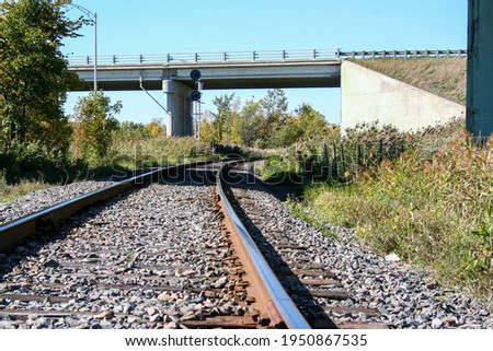 train rails and a underpass overpass near vaudreuil-dorion in quebec canada  stock photo