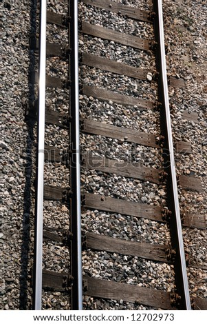 train rails vertical closeup for background use transportation industry