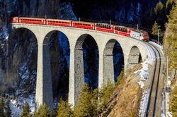 Train ride on mountain railroad bridge. Mountain railway bridge train ride. Railroad bridge in mountains