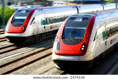 Train series - Two generic trains on a railway track. - stock photo