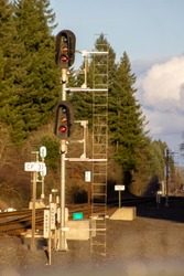 train signal with tress in the background
