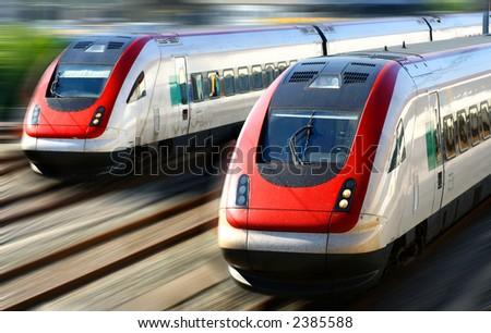 Train speeding along its tracks with motion blur.