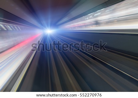 Train speeding in tunnel, motion blur #552270976