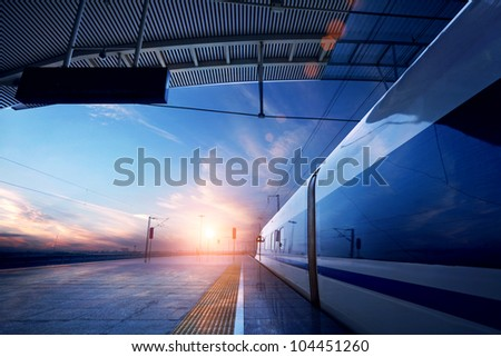 train stop at railway station with sunset #104451260