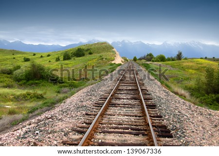 Train track in prairie landscape of Montana