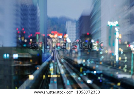 Train track motion blurred moving into bokeh light  city downtown, abstract background #1058972330