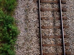 Train tracks and greenery - top view shot
