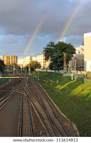 Train tracks and rainbow. Concept happy journey. Moscow