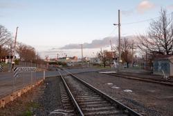Train Tracks at Rail Crossing, Ballarat, Victoria, Australia at Sunset