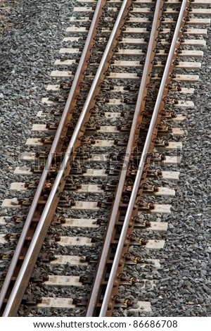 Train tracks from above in portrait orientation