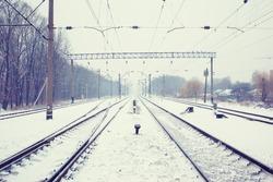 Train tracks in winter mist