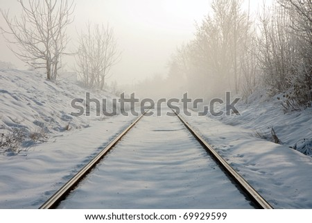 Train tracks in winter mist