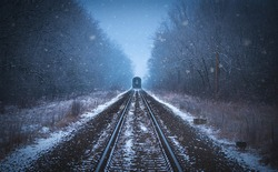 Train tracks in winter mist a snowy day