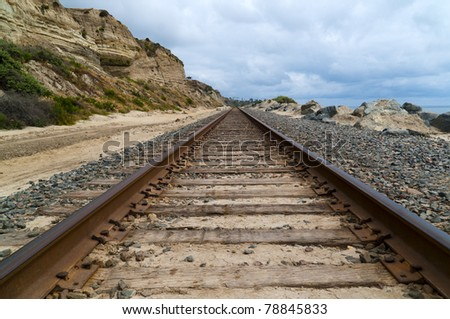 Train tracks on the coast of a Californa beach