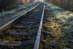 Train tracks winding between autumn colored trees in Anyksciai, Lithuania