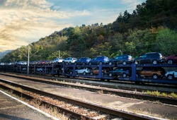 Train transporting cars.Autorack with new cars for export.