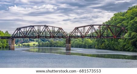 Train trestle bridge over lake