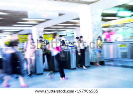 Train Tube station Blur people movement in rush hour