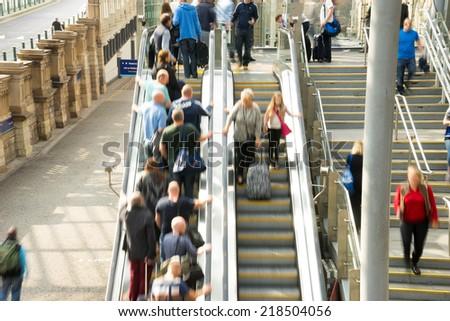 Train Tube station Blur people movement in rush hour at Edinburgh, Scotland, UK