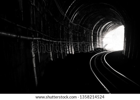 Train tunnel. Old railway in cave. Hope of life in the end of the way. Railroad of locomotive train in Thailand. Old architecture. Railway tunnel built in 1914. Travel and hope at the destination. Foto stock ©