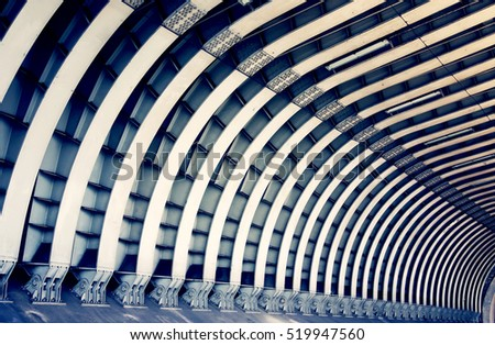 Train tunnel. Symmetric steel beams pattern. Abstract architecture, construction, transportation and travel concept #519947560