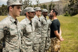 Trainer giving training to military soldier at boot camp