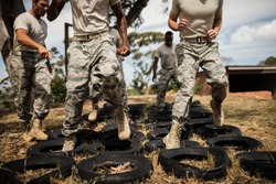 Trainer giving training to military soldiers at boot camp