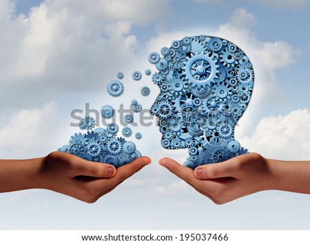 Training and development business education concept with a hand holding a group of gears transferring the wheels to a human head made of cogs as a symbol of acquiring the tools for career learning.
