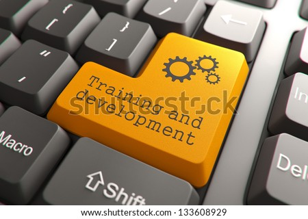 Training and Development, Orange Button on Computer Keyboard. Internet Concept.