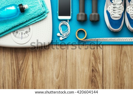 Training and sports equipment on a mat and weight scale, healthy lifestyle and workout concept, flat lay banner