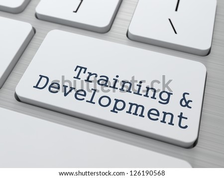 Training & Development - Button on Modern Computer Keyboard.