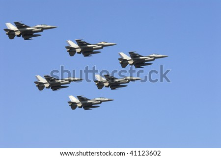 training flight of fighter jets on display
