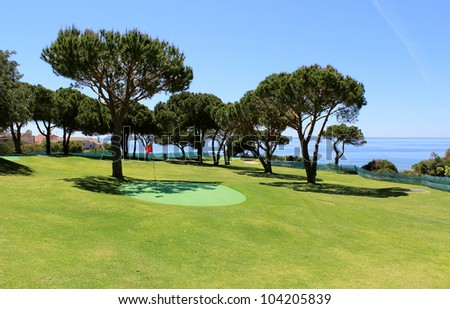 Training golf course in the Algarve coastline landscape. Portugal