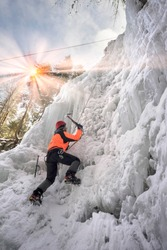 training of athletes on the frozen famous Manyavsky Falls in Manyava - Ukraine, Carpathians before going to the Alps on a glacier expedition to the glaciers