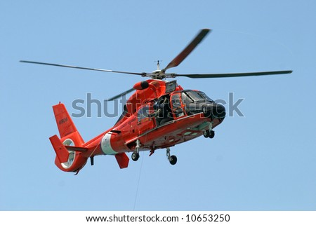 Training with the Coast Guard HH-65A Dolphin helicopter. The HH-65A is used to perform search and rescue; law enforcement, drug interdiction and military readiness. St Thomas, US Virgin Islands. - stock photo