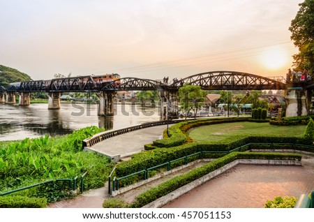 Trains for travel running on the old bridge over the River Kwai Yai at sunset is a historical attractions during World War 2 the famous of Kanchanaburi Province in Thailand