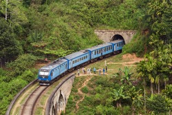 Trains pass. Kandy to Ella train crossing Nine Arches Bridge tunnel Demodara in Sri Lanka