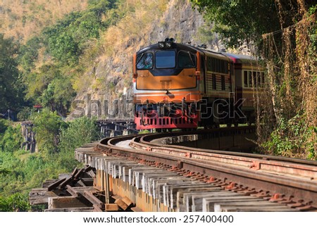 trains running on death railways track crossing kwai river in kanchanaburi thailand this railways important destination of world war II history builted by soldier prisoners