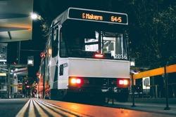 Tram at city station at night