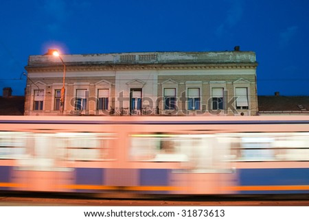 tram at night with motion blur