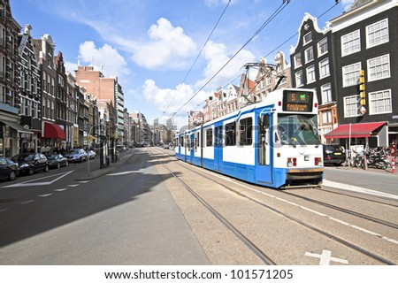 Tram driving in Amsterdam city center in the Netherlands