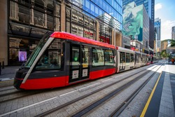 Tram moving through George St and Kent St in Sydney NSW Australia