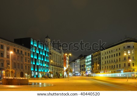 Tram on Brno square at night