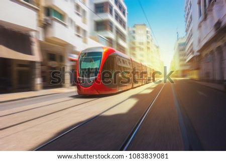 tram passing on railways in Boulevard Mohammed V, Casablanca - Morocco #1083839081